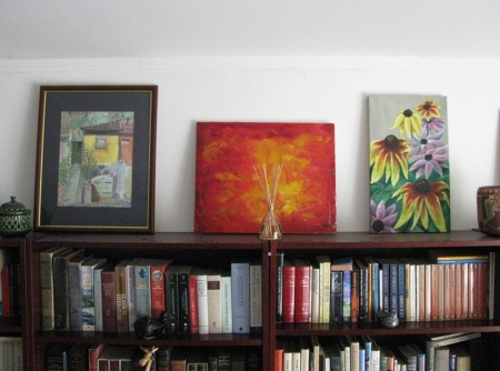 painting on bookshelf